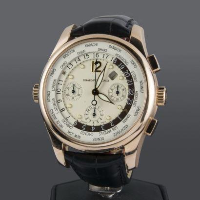 Reloj de pulsera para caballero GIRARD-PERREGAUX WORLD TIME, automático, caja en oro rosa y pulsera de piel.