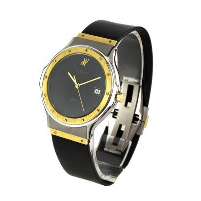 Reloj de pulsera para caballero HUBLOT, modelo  210 749-1521 100 2. Caja de 36mm en acero y oro de 18k. Brazalete en acero, oro y caucho negro. Broche en acero y oro.