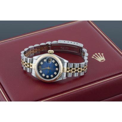 Reloj de pulsera para dama ROLEX OYSTER PERPETUAL DATE JUST, en acero y oro amarillo, pantalla azul  con brillantes engastados, lente cyclops. Con caja y certificado.