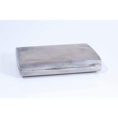 Polvera en plata, pps. XX.
