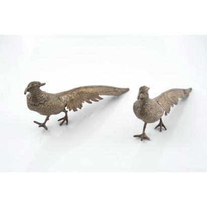 Pareja de pájaros en metal patinado y parcialmente dorado, siglo XX.