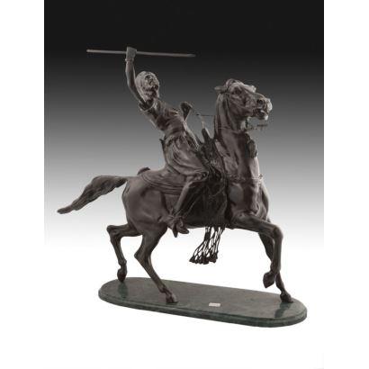 Figura en bronce sobre peana oval.