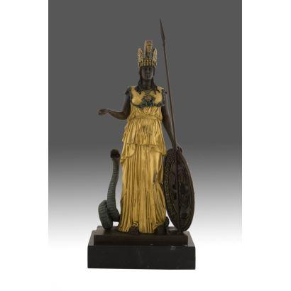 Figura en bronce patinado con detalles en dorado.