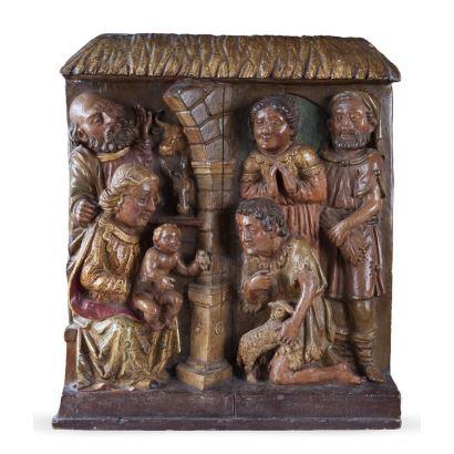 Antiguo retablo realizado en madera tallada, policromada y dorada. Escuela española.