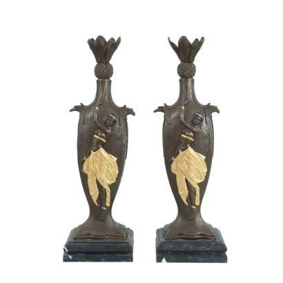 Pareja de jarrones en bronce patinado y dorado sobre peana de mármol, presentan decoración egipcia de damas sobre fondo con jeroglíficos. Siglo XX. Firmados: C.LOUCHET. Medidas: 45x14x12cm.