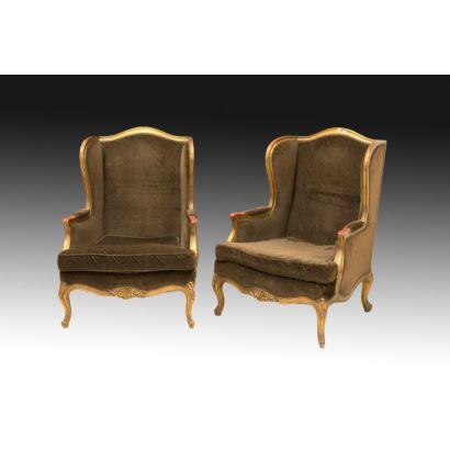 Pareja de sillones orejeros, estilo Luis XV, S. XIX.