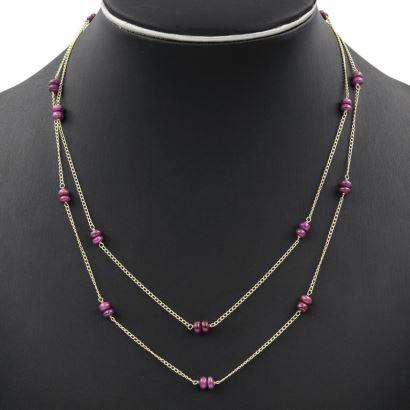 Gargantilla de doble cadena de oro con rubíes
