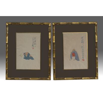 Bonita pareja de dibujos enmarcados, representan curiosos personajes orientales con grafías y sello rojo. Medidas: 45x35cm s/m 28x19cm.