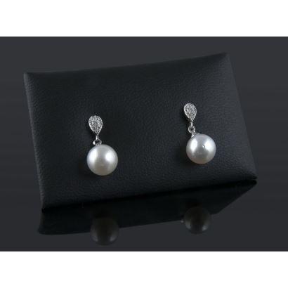 Pendientes de oro blanco con brillante dentro de lágrima de la que pende una perla australiana. Total brillantes: 0,09cts.