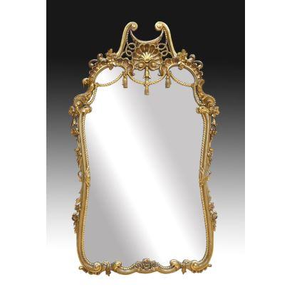 Espejo en madera dorada y tallada, siglo XX.