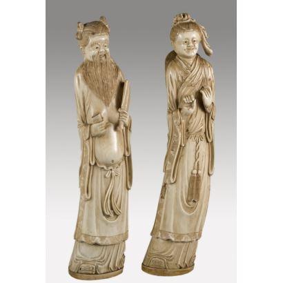 Esculturas. Pareja de figuras realizadas en resina
