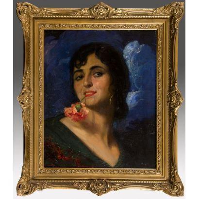 MANUEL BENEDITO Y VIVES 1875-1963. óleo sobre tabla. Retrato de andaluza con clavel en la boca sobre fondo azul. Firmado y fechado en ángulo inferior derecho M.Benedito 1926. 61x52cm/44x36cm