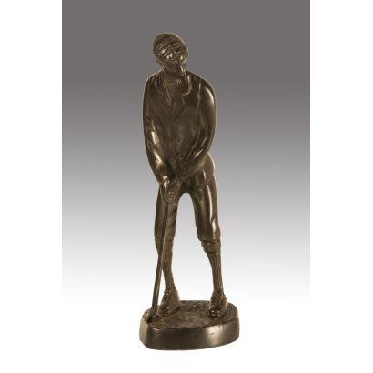 Figura en bronce sobre peana circular.