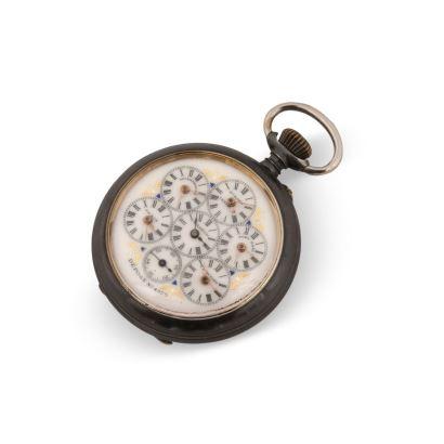 Reloj de bolsillo con horario mundial.  En estado de marcha.  Medidas: 5,5 cm diámetro.