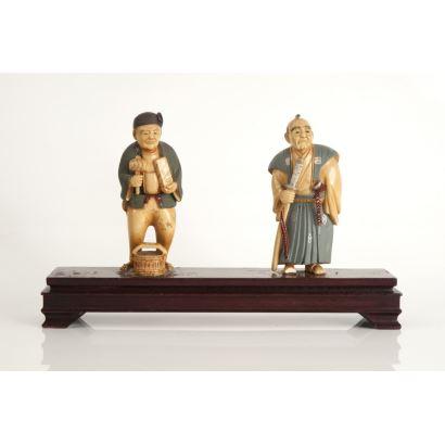 Pareja de figuras en marfil, China, siglo XX.