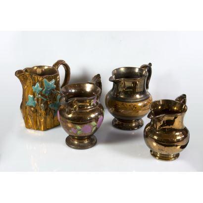 Colección de cuatro jarros de Bristol, Reino Unido.