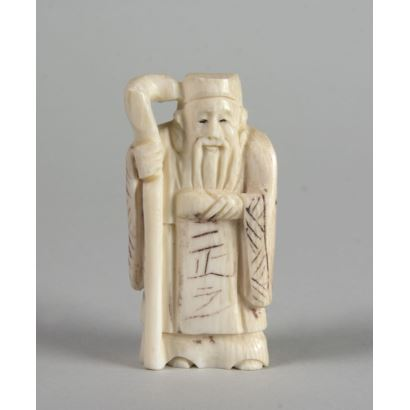Figure carved in ivory. 5 cm