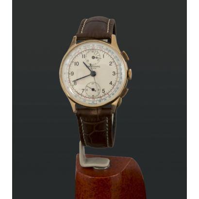 Reloj Chronographe suizo en oro, años 50.