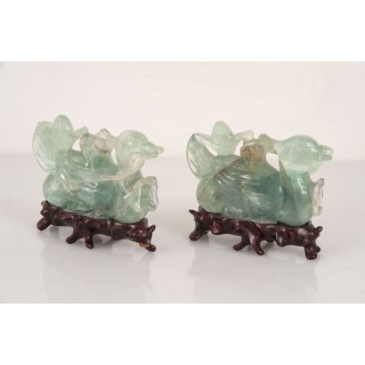 Objects. Pair of Chinese figures made in green jade on wooden base.