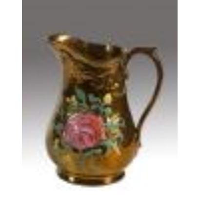Jarra de cerámica dorada de Bristol, con decoración floral. Siglo XIX. Medidas: 19x17cm.