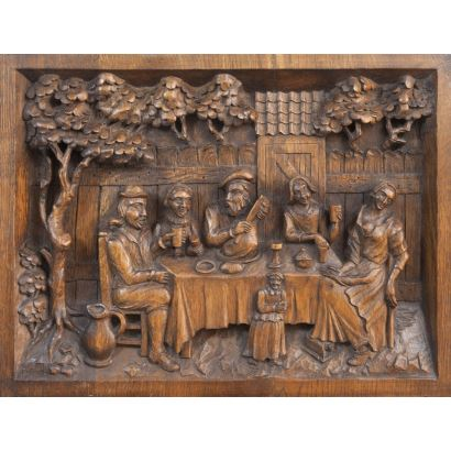 "Low rectangular relief carved in wood, genre scene. ""Characters around the table"". Measures: 33x44cm."