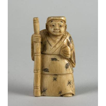 """Stick figure"". Netsuke carved in ivory."
