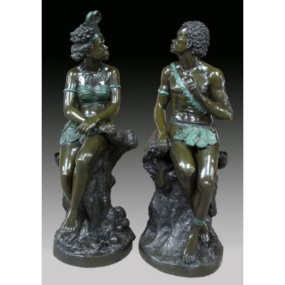 "Pair of sculptures made in patinated bronze, following models by Frédéric Eugène PIAT (1827-1903). Twentieth century. ""Nubian couple"". Measures: 166x65x65cms."