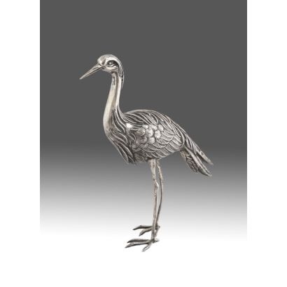 Heron figure made of sterling silver, realistic taste. s.XX. Weight: 70g Measures: 17x18cm.