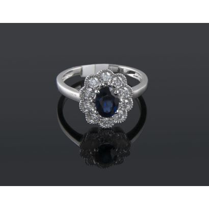 Rosette ring in white gold, with oval sapphire bordered by diamonds totaling 0.76cts.