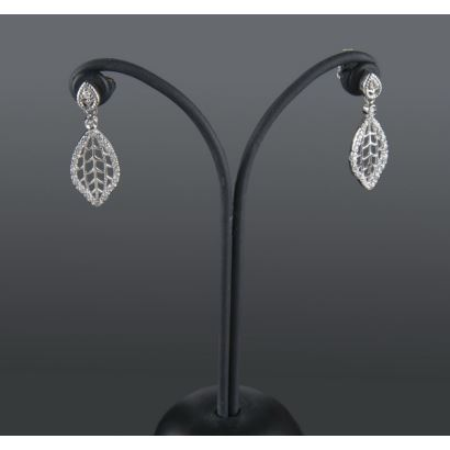 Long earrings in white gold as an openwork leaf, are decorated with diamonds that add 0.32cts.