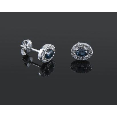 Oval earrings with white gold frame, with central sapphire bordered by diamonds totaling 0.26cts.