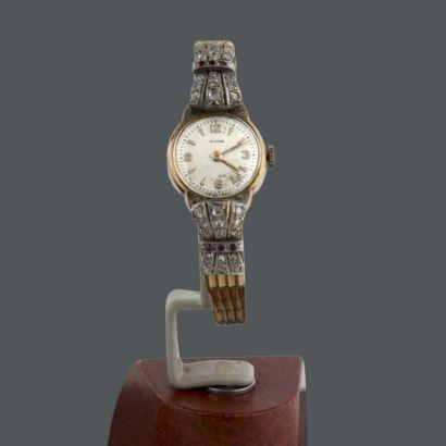 Reloj de señora con diamantes y rubíes.
