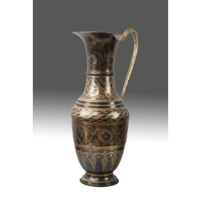 Jug in bronze and damascene bronze, rich vegetable decoration. PP.S.XX. Measures: 53x30cm.