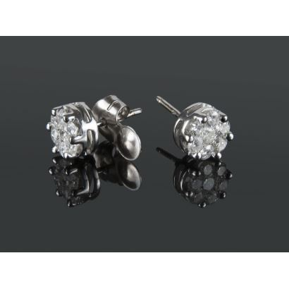 Rosette earrings with white gold frame, they contain brilliant claw set 1.36cts.