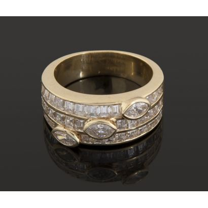 Magnificent yellow gold ring, with three marquise cut diamonds totaling 0.45cts and three rows totaling 36 princess cut diamonds (about 2 cts). Diameter: 16mm Weight: 7.8g