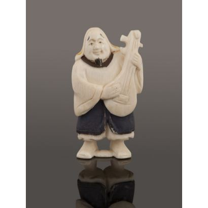 Netsuke carved in ivory and polychrome.