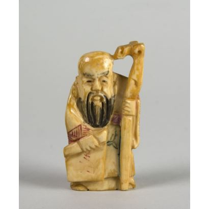 """Character with roll and cane"". Carving and polychrome engraving in ivory."