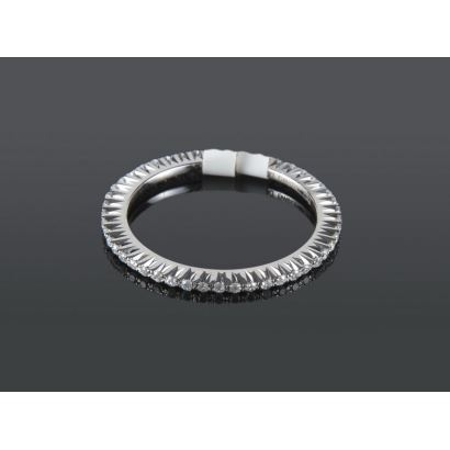 Endless white gold ring, with brilliant HS set in claw totaling 0.24 cts.