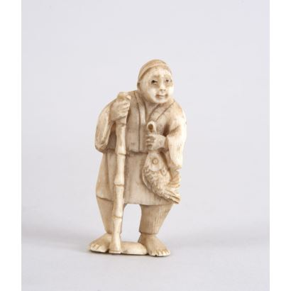 "Netsuke carved from ivory. ""Angler with rod"". Height: 6cm."
