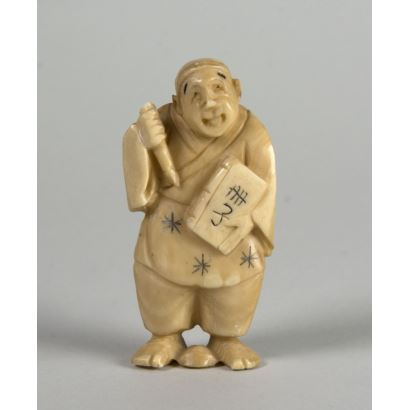 "Netsuke in ivory. ""Character with book and brush""."