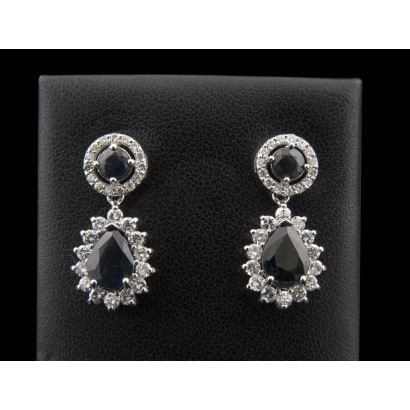 Magnificent white gold earrings, with brilliant-cut and pear-shaped sapphires bordered by diamonds (1,5cts).