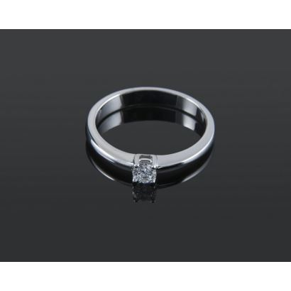 Elegant solitaire in white gold, with brilliant 0.21cts set in claw.