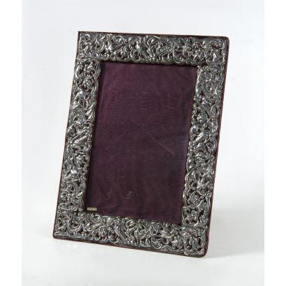 Embossed silver frame.
