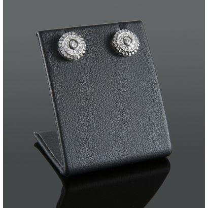 White gold rosette earrings with diamonds totaling 0.32cts.