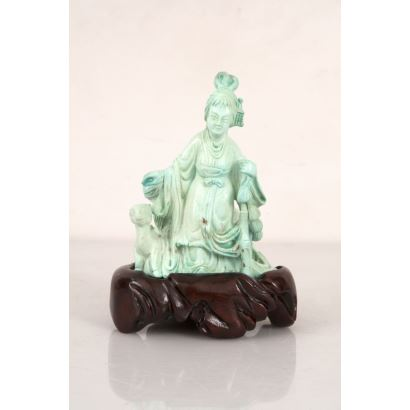 Chinese figure carved in turquoise stone on wooden base.