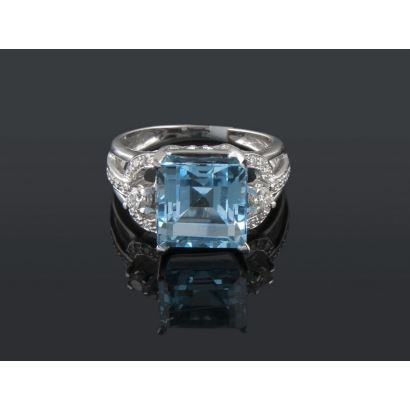 White gold ring with princess-cut blue topaz and diamonds totaling 0.55cts.