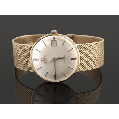 Elegante reloj de pulsera en oro amarillo. OMEGA AUTOMATIC GENÈVE. Con dial de fecha.  Peso: 65,5g.
