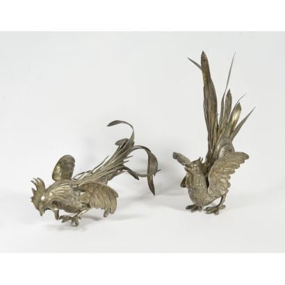 Silver. Pair of roosters in silver.