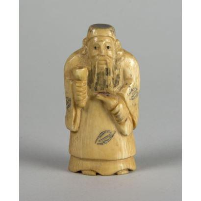Netsuke in ivory. Pee S.XX.